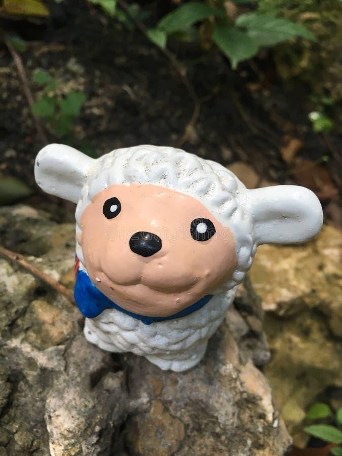 White sheep statue in the garden royalty free stock photos