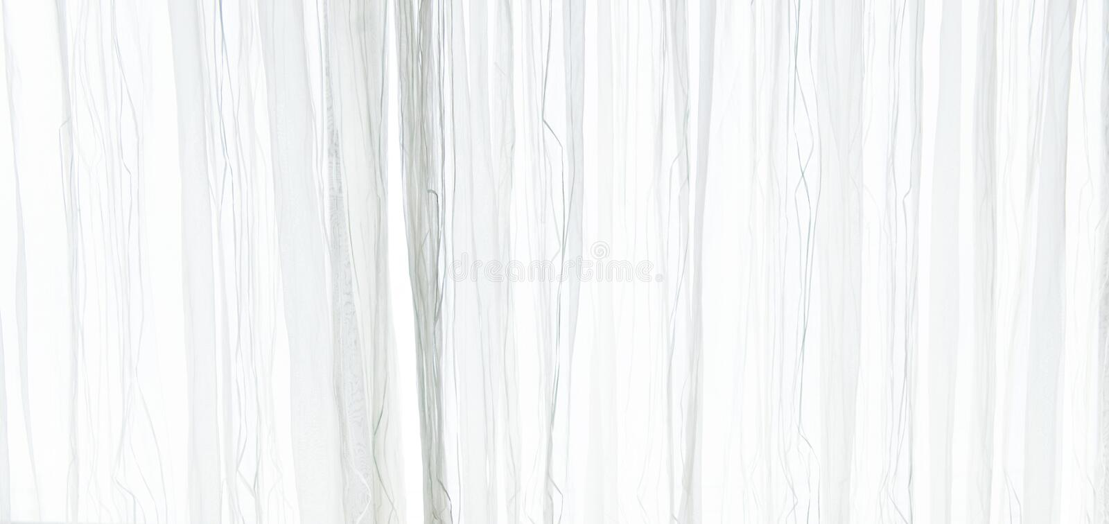White sheer curtain texture background in daylight atmosphere of apartment`s interior. White transparent curtain. Background stock photos
