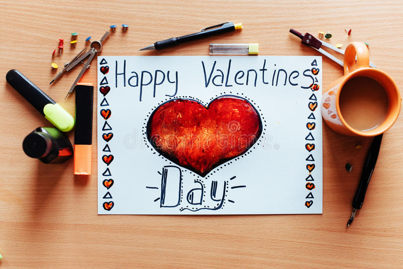 White sheet painted with a red heart. With lots of stationary objects. Valentine`s Day stock image