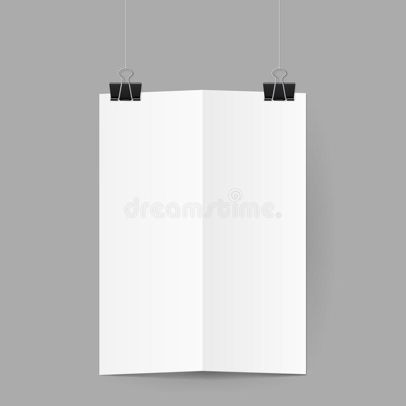 White sheet of paper folded in half handing on black binder clips. White sheet of paper folded in half. The paper hangs on black binder clips royalty free illustration