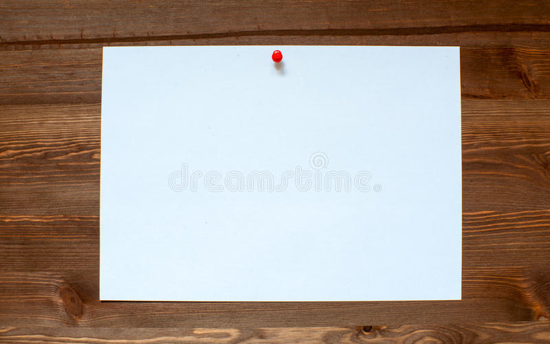 The white sheet on a wooden background. royalty free stock photos