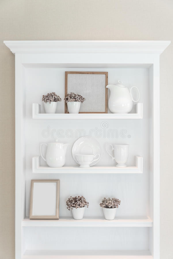 White shelf with vintage porcelain tableware in house. stock image