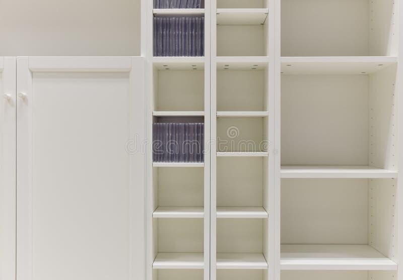 White shelves. Closet detail - empty white shelves stock image