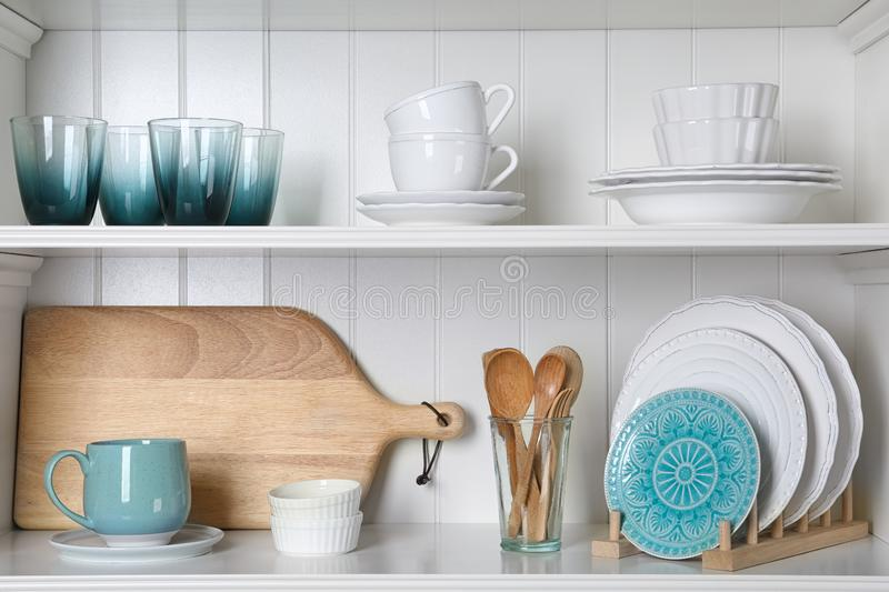 White shelving unit with set of dishware royalty free stock photo