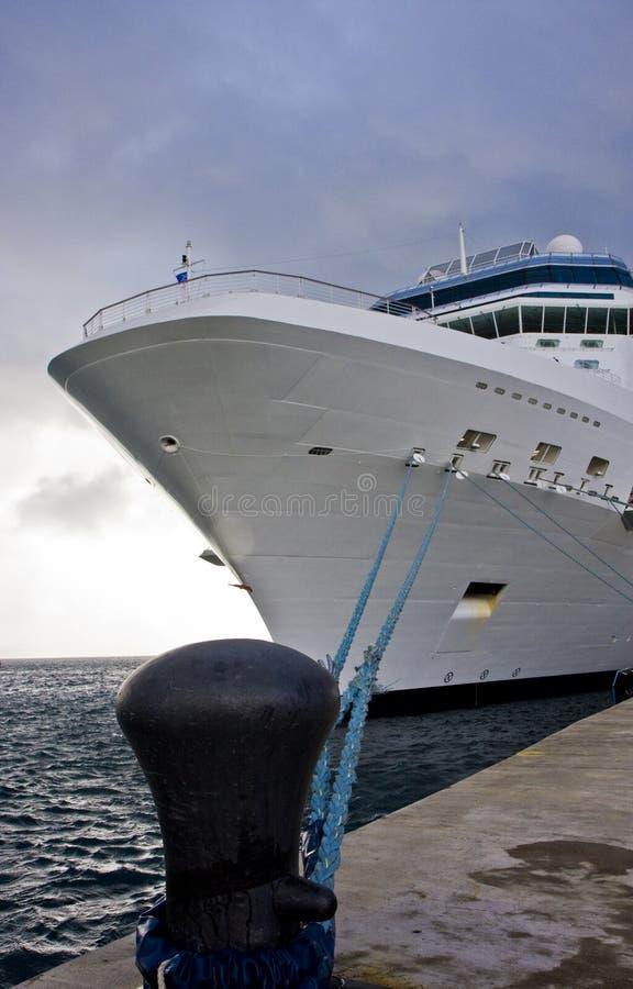 White Ship Tied To Black Bollard Stock Photo
