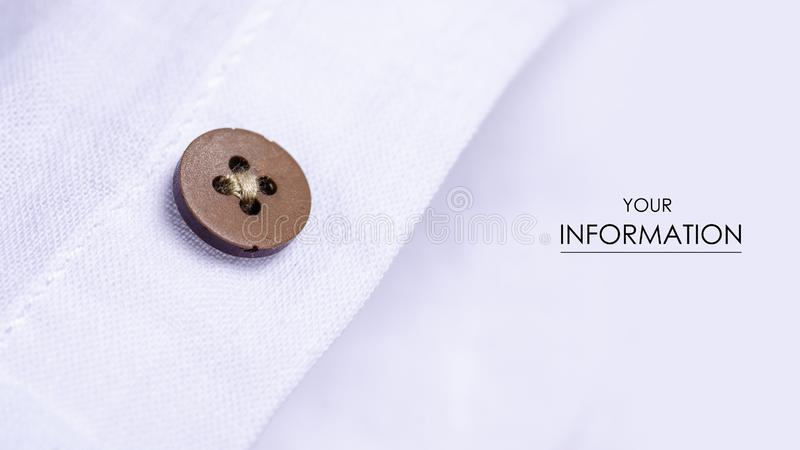 White shirt button fabric macro material clothes detail pattern stock photo