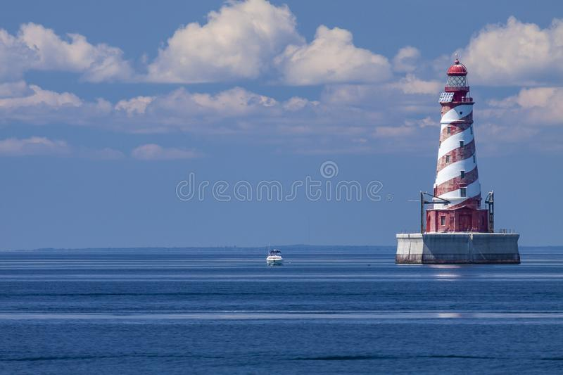White Shoal Lighthouse. A red and white striped offshore lighthouse on Lake Michigan royalty free stock photos