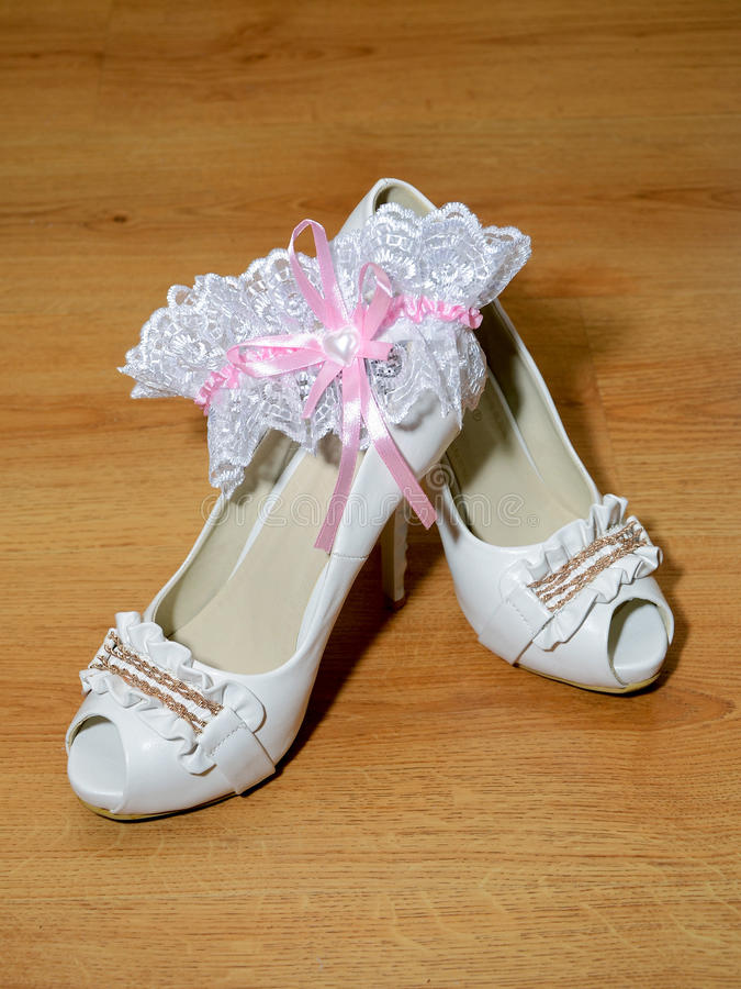 Download White shoes and a garter stock photo. Image of personal - 25121832