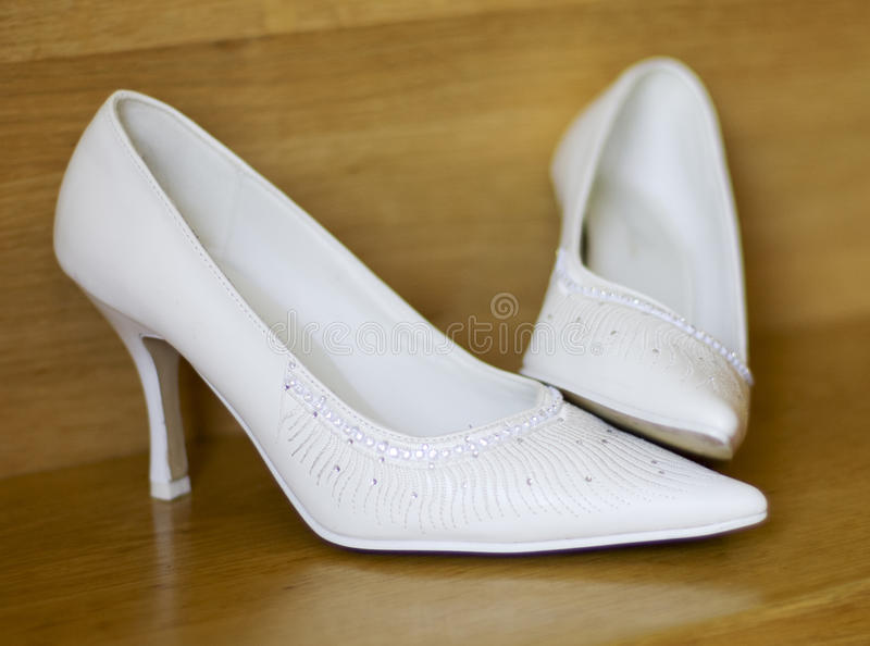 White shoes for wedding. With brown backgrund stock photography
