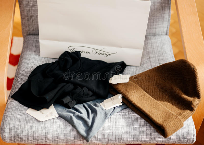 White shopping bag with AMERICAN VINTAGE fashion brand. PARIS, FRANCE - OCT 24, 2016: White shopping bag with AMERICAN VINTAGE fashion brand logotype on the stock photo