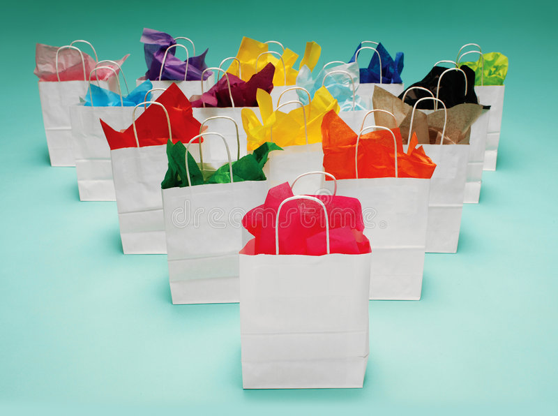 White Shopping Bags on Green royalty free stock images