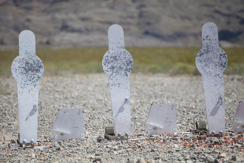 Three shotgun silhouette targets stock image
