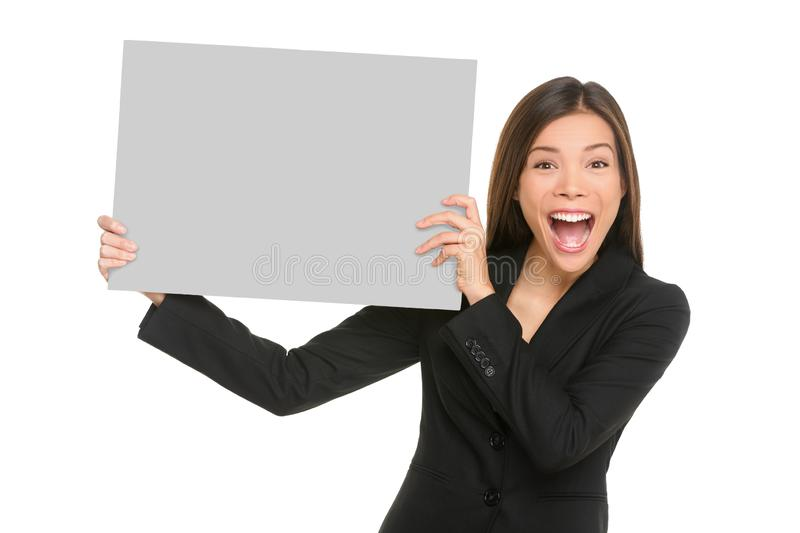 White sign happy Asian business woman holding blank card isolated on white background in studio portrait. Screaming excited stock photos
