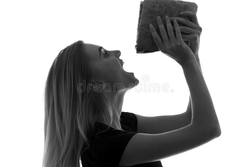 White silhouette of a woman eating a burger royalty free stock photos