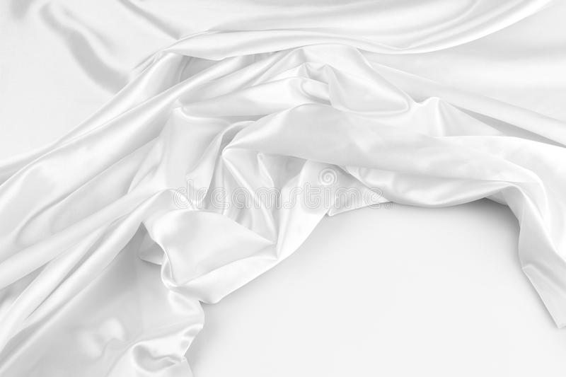 White silk. Closeup of rippled white silk fabric royalty free stock images