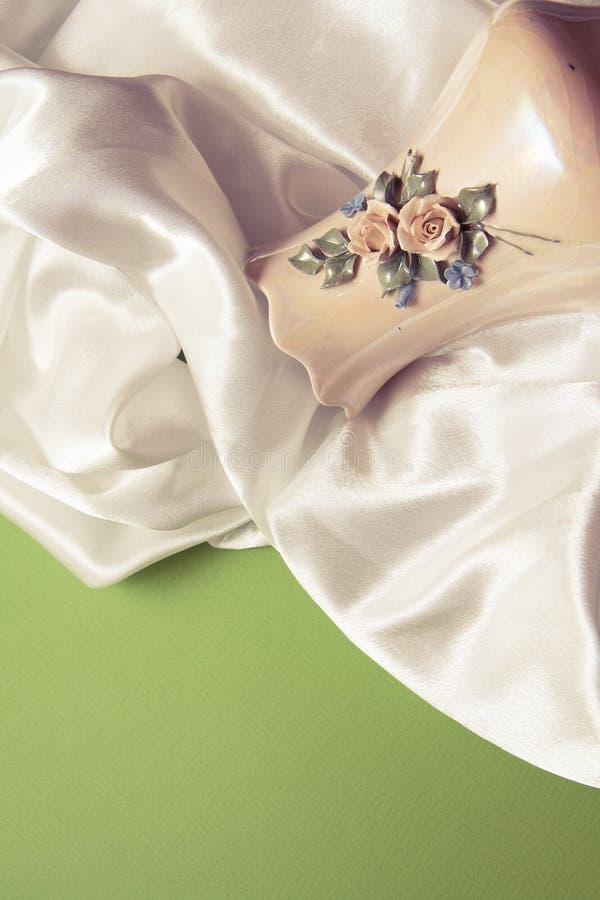 White silk drapery. Curvy white silk drapery on dark background royalty free stock photo