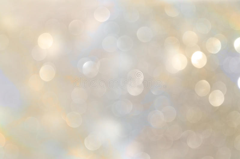 White and silver abstract bokeh lights. defocused background royalty free stock images