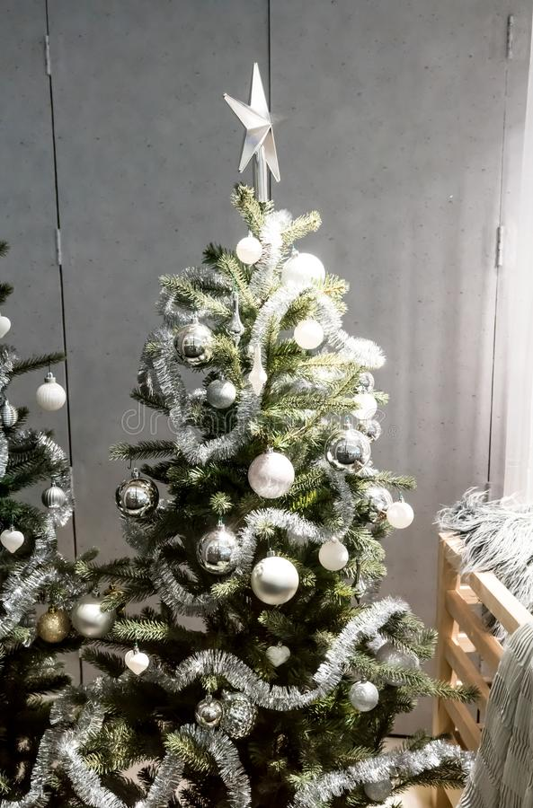 White And Silver Decorative Christmas Tree With Tinsel ...