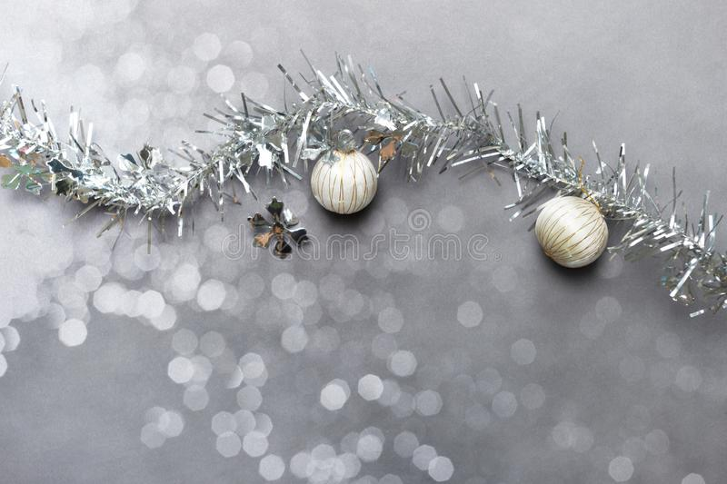White silver ornamental ball and snowflake with ribbon for Christmas holiday party decoration soft light bokeh background stock photos