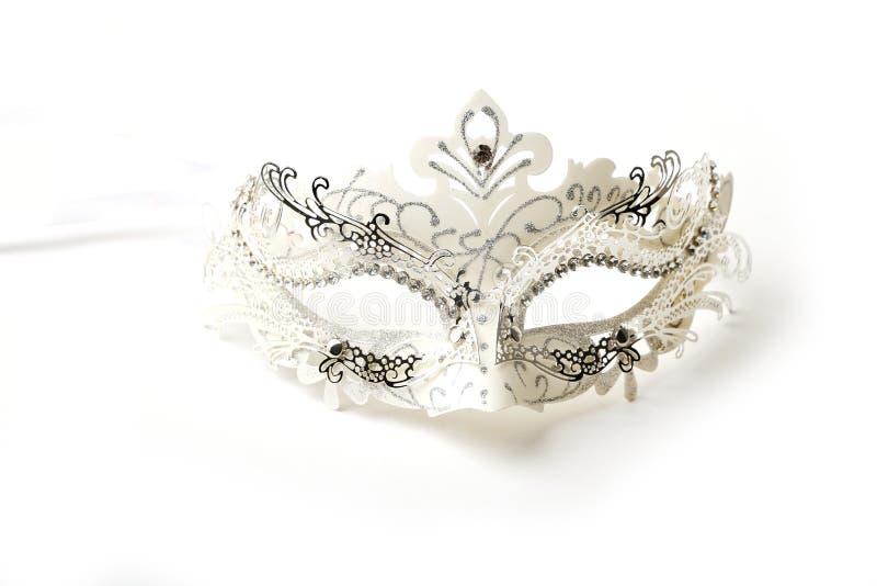 White and Silver Ornate Masquerade Mask on White Background stock photo