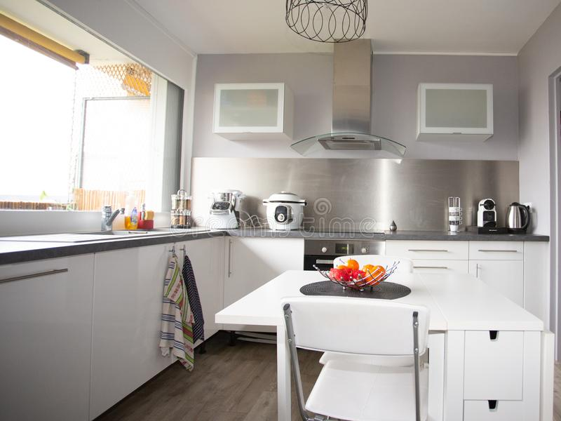 White simple home interior kitchen with nobody. A white simple home interior kitchen with nobody stock images