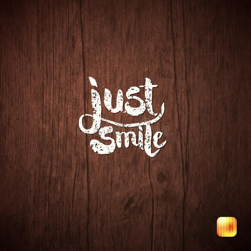 White Simple Text concept Just Smile on Wood. royalty free stock photo