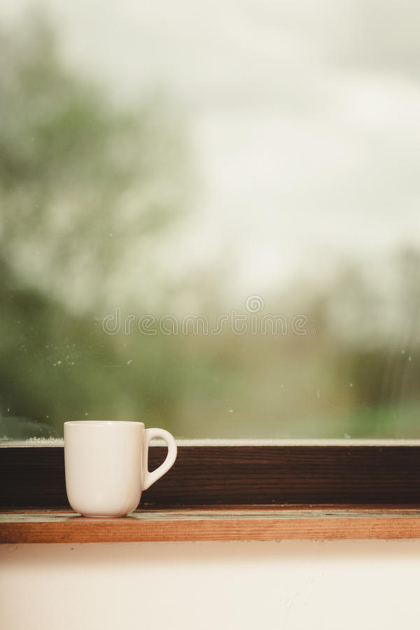 White single tea or coffee mug on window. Sill royalty free stock photos
