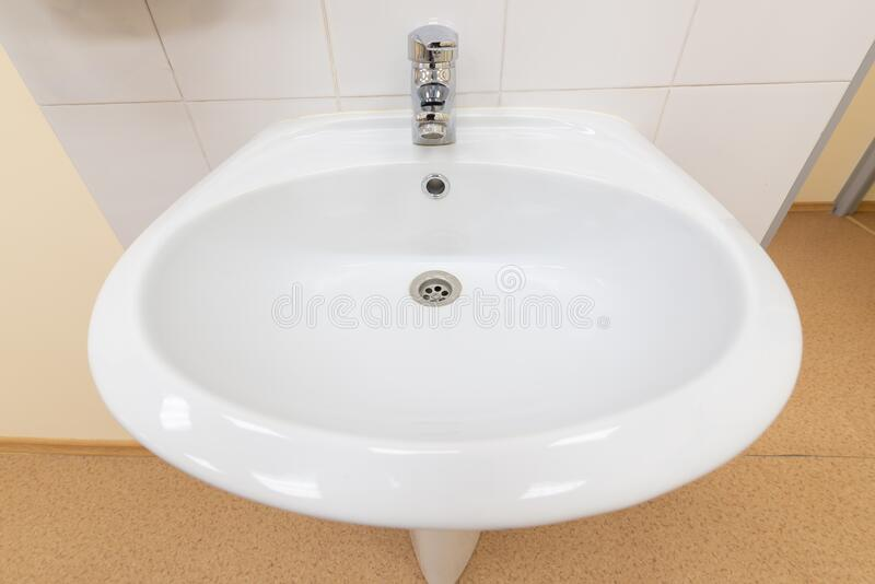 White sink with medical facility shot on wide angle lens royalty free stock image