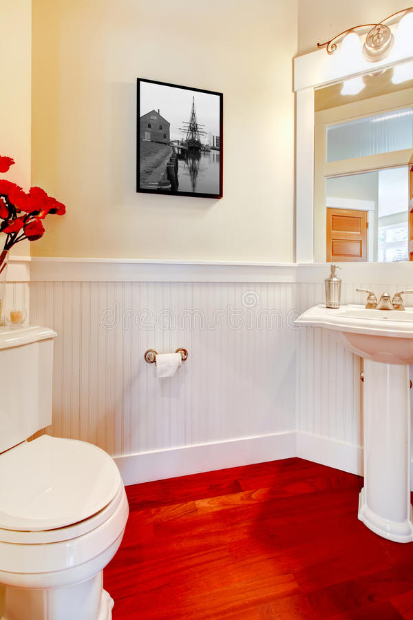 White Small Elegant Bathroom With Red Wood Floor. Stock ...