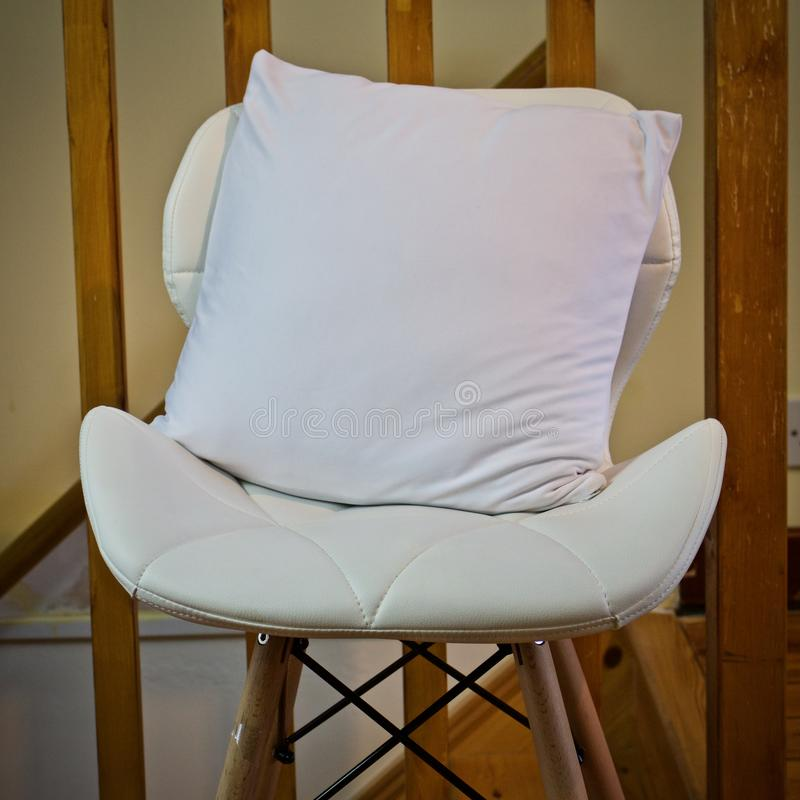 White small pillow mockup. White small pillow on the chair. Small pillow mockup royalty free stock image