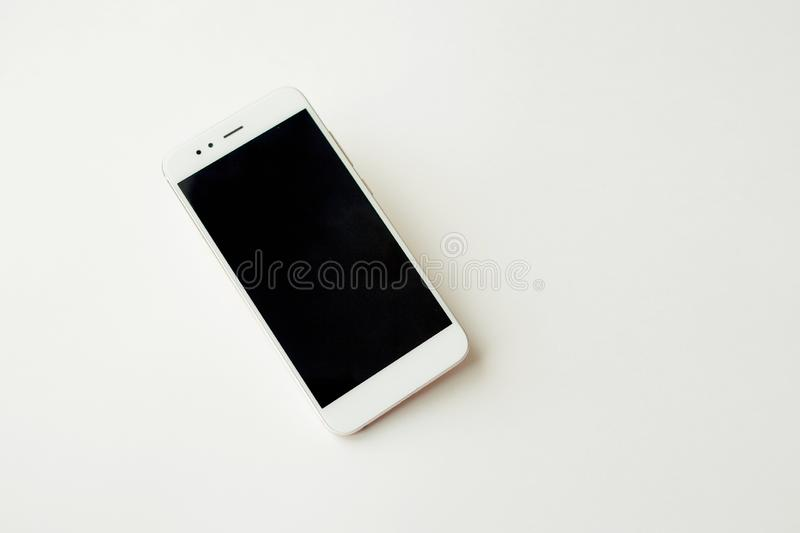 White smartphone on white background mockup. Phone, modern technologies social networks and applications. royalty free stock photos