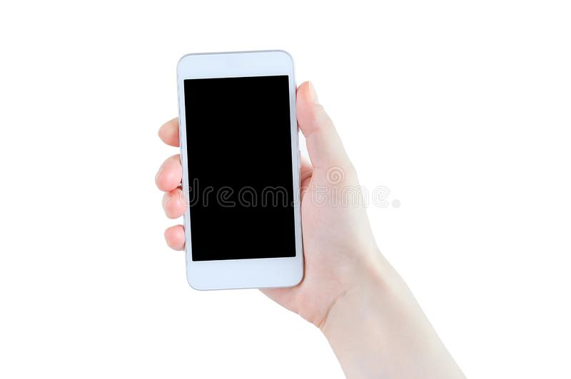 White smartphone with a black display in the hand of a Caucasian girl. royalty free stock image