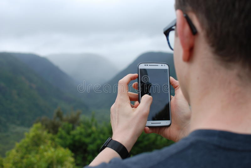 White Smartphone Held By A Man Free Public Domain Cc0 Image