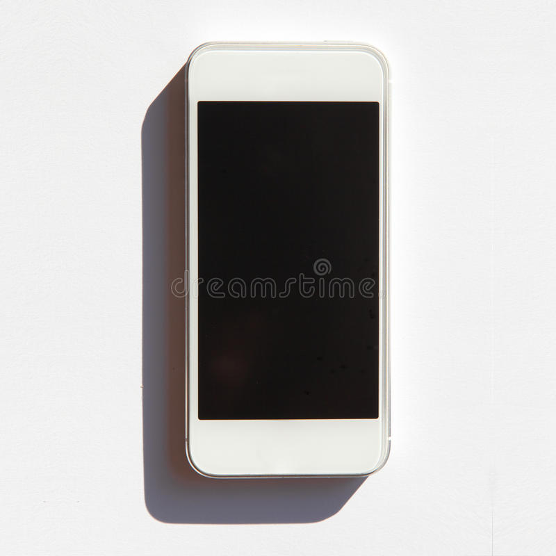 White smartphone with shadow isolated royalty free stock image