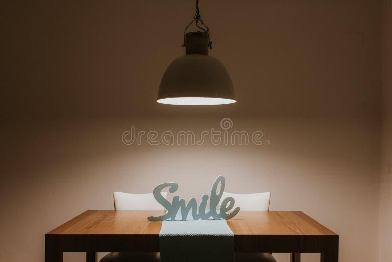 White Smile Cutout Signage on Table royalty free stock photo