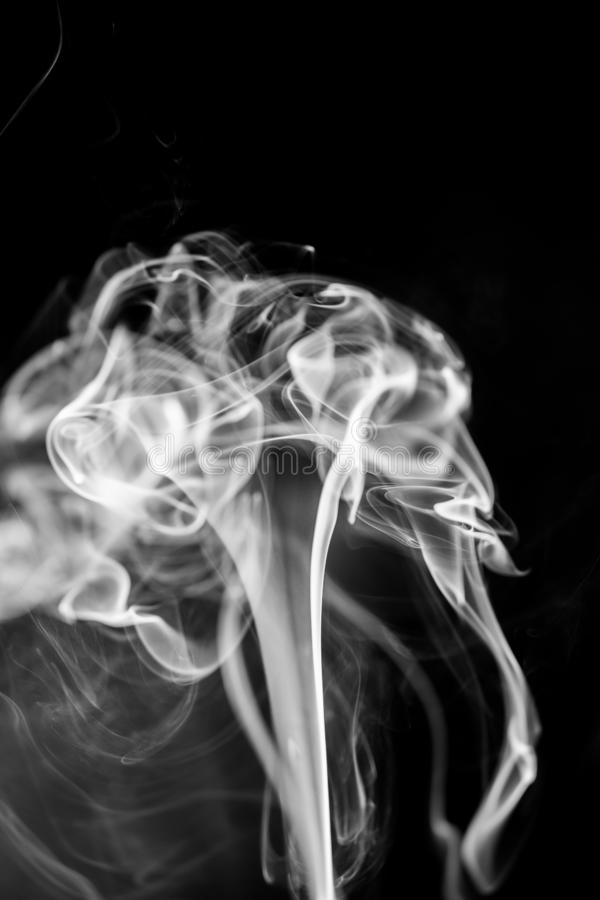 White smoke on black background royalty free stock photos