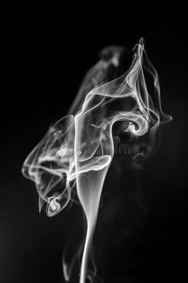 White smoke on black background stock image
