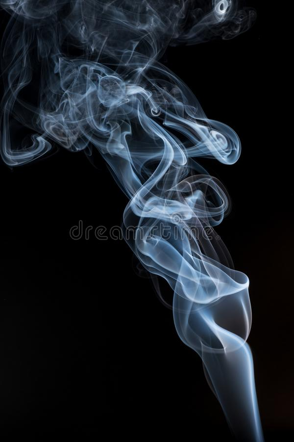 White smoke smoke on black background . stock image