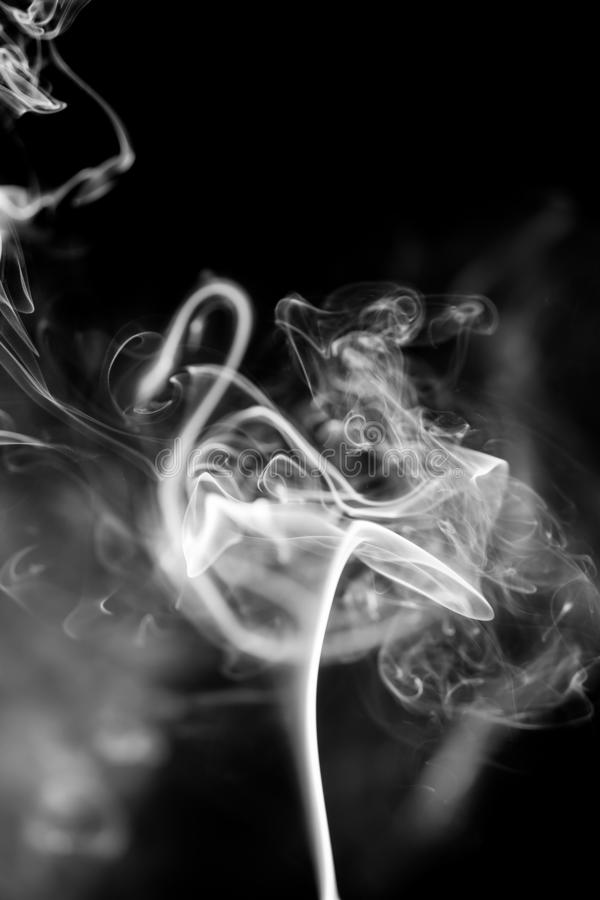 White smoke on black background royalty free stock images