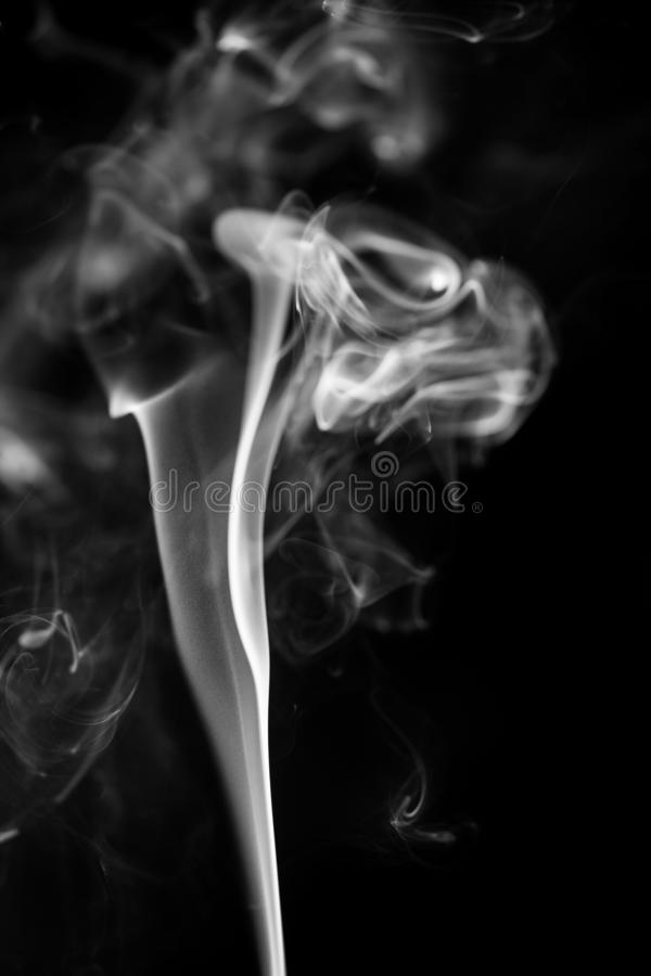 White smoke on black background stock photos