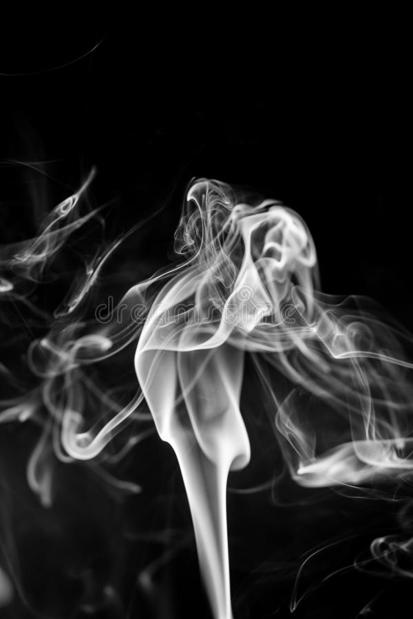 White smoke on black background stock photo