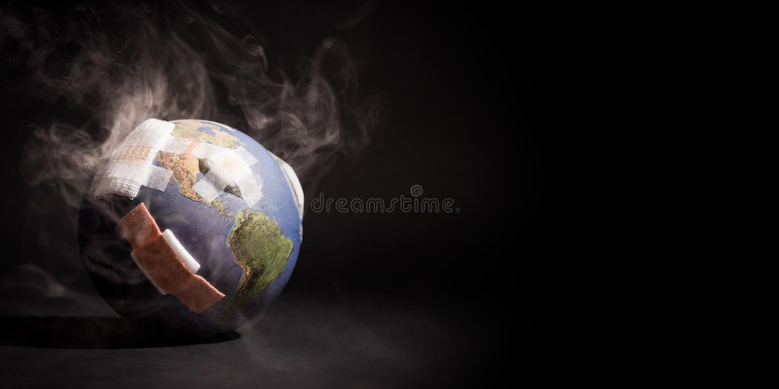White smoke cover around the globe World full of bandages, demonstrating impact of global warming, climate change, pollution. White smoke cover around the globe royalty free stock photos