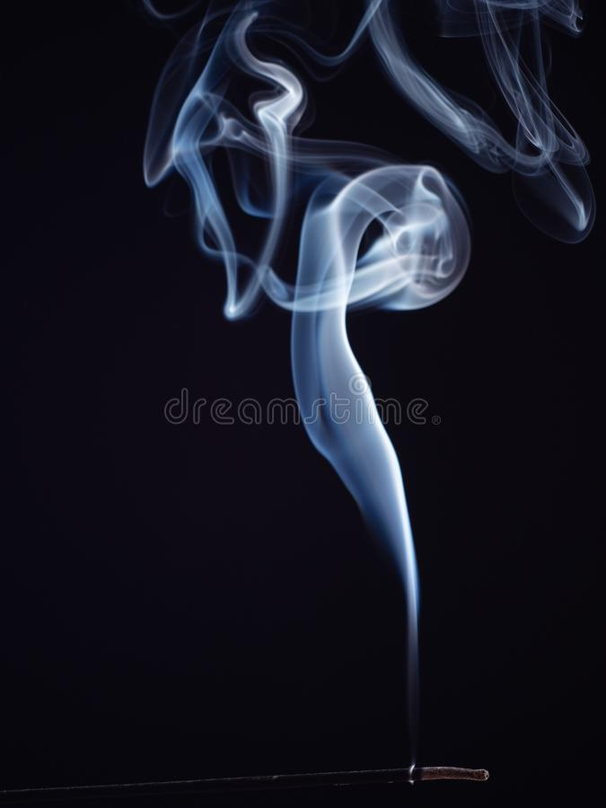 White smoke isolated on black background, close up view. Smoke pattern, brush effect. Burning incense, abstract. Background. Fragrance for relaxation and royalty free stock images