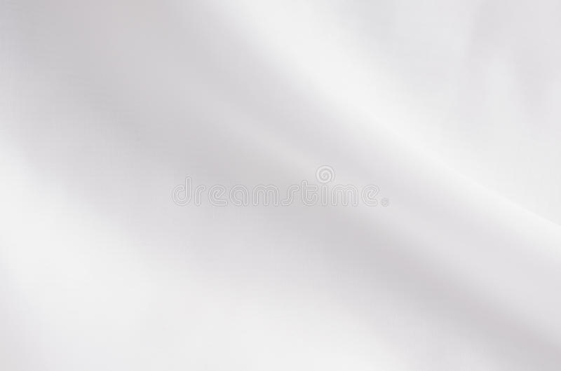 White smooth elegant silk or satin fabric texture with liquid wave. White smooth elegant silk or satin fabric texture with liquid wave royalty free stock photo