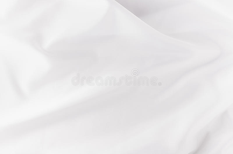 White smooth luxury silk or satin texture with liquid waves for wedding background. White smooth luxury silk or satin texture with liquid waves for wedding stock photo