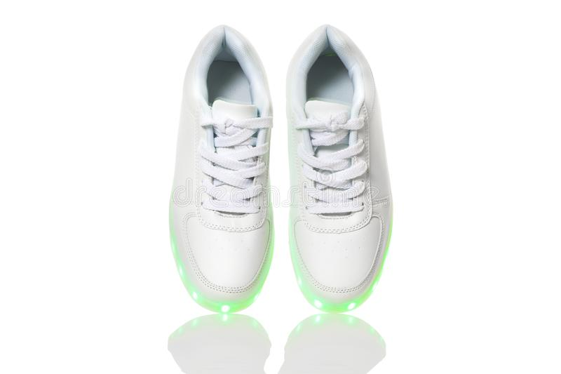 White sneackers with led light sole stock image