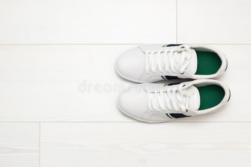White sneakers on white wooden floor. royalty free stock photo