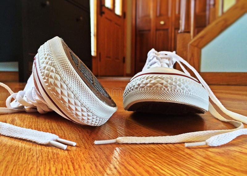 White sneakers on wooden floor stock photo