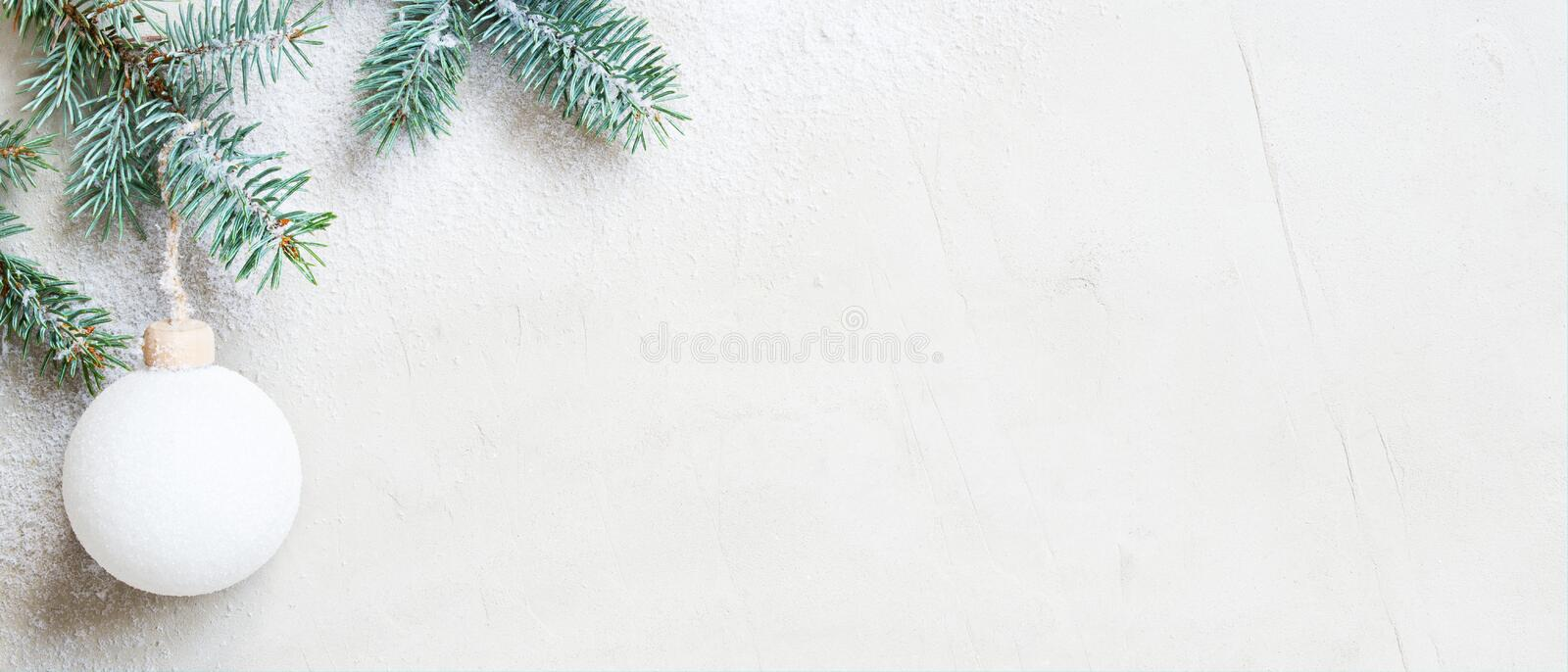 White snow Christmas banner with Christmas tree branch and ball royalty free stock photos