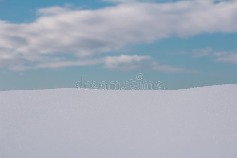 White snow with cloudy sky, prepare for product placement stock photos